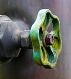 Old valve of a pipeline close up Stock Photography