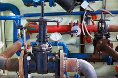 Old valves on the cold water pipeline. Industrial background. stock photography