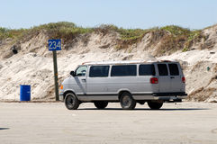 Old van driving on the beach Stock Image