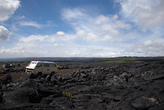 Old van in the middle of lava field Stock Photos
