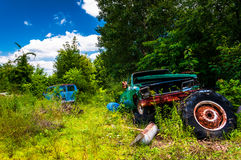 Old van and truck in a junkyard Stock Photos