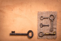 Old various keys on paper Stock Photography