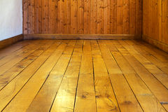 Old varnished wooden floor and wall of  room Royalty Free Stock Photography