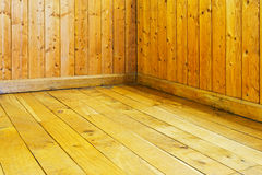 Old varnished wooden floor and wall of  room Royalty Free Stock Photos