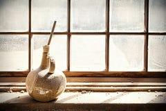 Old vase on grungy window. Royalty Free Stock Photos