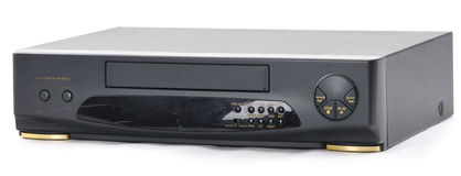 Old VCR. Old video cassette recorder on the white background. Front side Stock Photography