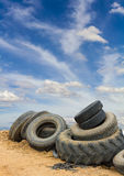 Old vehicle tires soil sky. Stock Photo