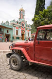 An old vehicle used for tours parked in the centre of Vilcabamba Royalty Free Stock Photo