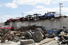 Old vehicles in an auto salvage yard. Being recycled for parts and scrap metal Stock Photo