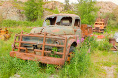 Old vehicles left to rust at an outdoor museum in yellowknife Stock Images