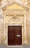 Old venetian door facade in city of Rethymno Stock Images