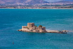 Old Venetian fortress Bourtzi in Nafplio, Greece. Bourtzi fortress, a prison in the sea in front of Nafplio town the first capital of Greece stock photography