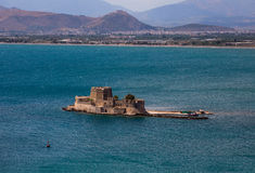 Old Venetian fortress Bourtzi in Nafplio, Greece. Bourtzi fortress, a prison in the sea in front of Nafplio town the first capital of Greece royalty free stock images