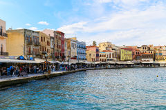 Old Venetian Harbor of Chania. Chania, Greece - October 28, 2014: Part of the waterside promenade at the Venetian harbor in Chania. There are lots of people Royalty Free Stock Photos