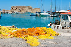 Old Venetian harbour. Crete, Greece. Fishing nets and fishing boats near Venetian fortress in the port of Heraklion. Crete, Greece Stock Photography