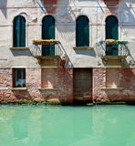 Old venetian house standing in water Stock Photography