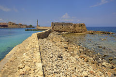 Old venetian lighthouse at harbor. Chania, Crete, Greece Stock Photography