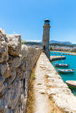 Old venetian lighthouse at harbor. Crete, Greece Royalty Free Stock Photo