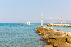 Old venetian lighthouse at harbor in Crete, Greece. Royalty Free Stock Image