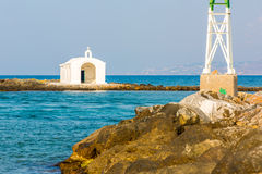 Old venetian lighthouse at harbor in Crete, Greece. Stock Photo