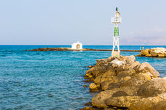 Old venetian lighthouse at harbor in Crete, Greece. Stock Photography
