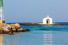 Old venetian lighthouse at harbor in Crete, Greece. Small cretan village Kavros. Royalty Free Stock Photography
