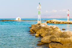 Old venetian lighthouse at harbor in Crete, Greece. Small cretan village Kavros. Stock Photography
