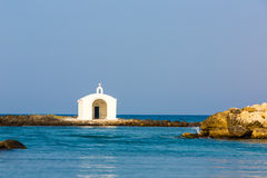 Old venetian lighthouse at harbor in Crete, Greece. Small cretan village Kavros. Stock Photos