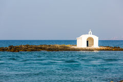 Old venetian lighthouse at harbor in Crete, Greece. Stock Image