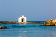 Old venetian lighthouse at harbor in Crete, Greece Royalty Free Stock Photography