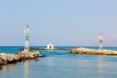 Old venetian lighthouse at harbor in Crete, Greece. Small cretan village Kavros. Travel Background Stock Image