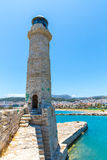 Old venetian lighthouse at harbor. Rethymno Stock Photo
