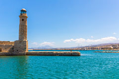 Old venetian lighthouse at harbor. Rethymno, Crete Stock Image