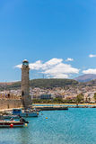 Old venetian lighthouse at harbor. Rethymno, Greece Stock Images