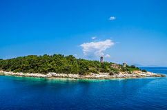 Old Venetian lighthouse of Port Fiskardo on Kefalonia island, Gr Royalty Free Stock Images