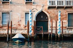 Old Venetian Palazzo With A Parked Boat royalty free stock image