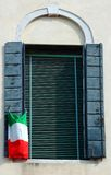 Old venetian window with italian flag Royalty Free Stock Photo