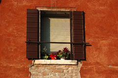 Old Venetian window at sunset,Italy Royalty Free Stock Image