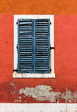 Old Venetian Window. Venice, Italy. A closed window on an old red wall in Venice, Italy Royalty Free Stock Photography