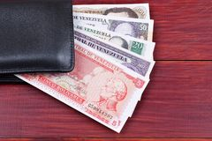 Old Venezuelan money in the black wallet Stock Photography