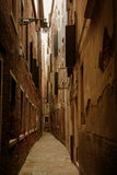 Old Venice street. Old street in Venice retouched as oil style stock images