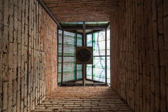 Old ventilation fan under the roof. Inside old brick wall building royalty free stock image