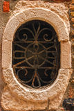 Old ventilation. Hole decorated with the forged iron lattice Stock Image