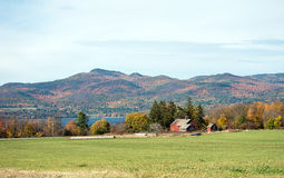 Old Vermont barns. Old barns on the edge of a Vermont field in the fall with the Adirondak mountains of New York in the background Stock Photography
