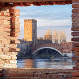 Old Verona town, view through brickwall window Stock Image