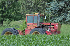 An Old Versatile Tractor. Versatile is a Canadian brand of agricultural equipment that has produced augers, swathers and combine harvester. In the 1970s that had Royalty Free Stock Photo