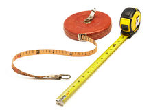 Old versus new. Old and new tape measure isolated on white royalty free stock images
