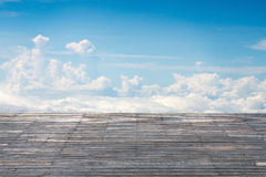 Old vertical striped wooden terrace with sunny sky cloudscape. Background Royalty Free Stock Photos