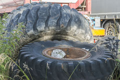 Old very big tires from a construction machine on a dump. Outdoor stock photos