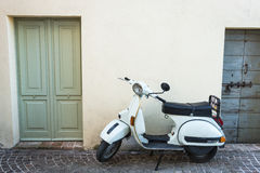 Old Vespa scooter on italian alley Stock Photo